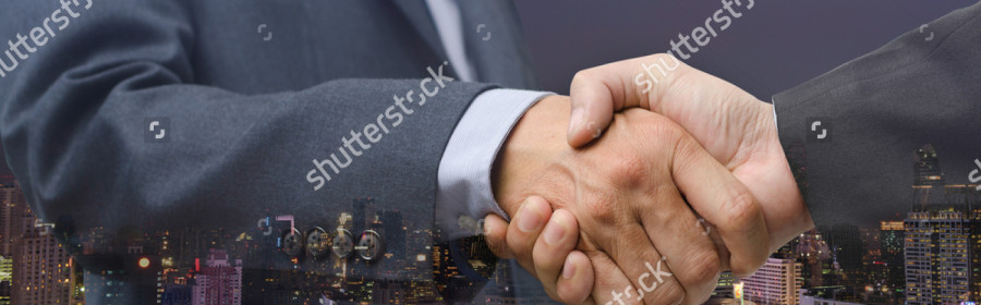 stock-photo-double-exposure-of-business-men-handshake-and-city-night-business-agreement-concept-twilight-sky-519342997